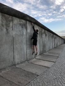 Jumping to touch the top of the wall