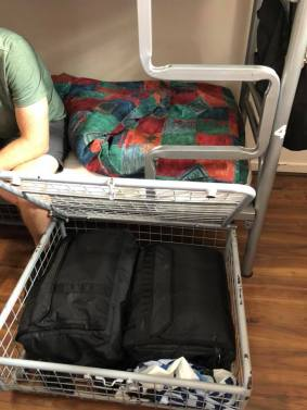 Luggage cage under bed