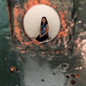 Looking hole in the jail cell