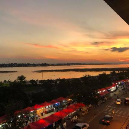 View of the river and nightmarket at sunset